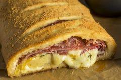 Homemade Cheesy and Meaty Italian Stromboli. With Marinara Sauce Stock Photos