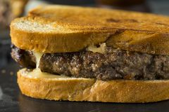 Homemade Cheesy Patty Melt Sandwich. With Cheese and Onions royalty free stock photography