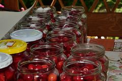 Homemade cherries conserve preserved. To glass stock image