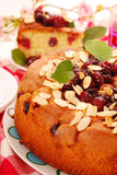 Homemade cherry cake with almonds Stock Image