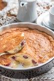 Homemade cherry flan. In dark cooking dish Stock Photo