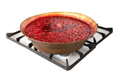 Homemade cherry jam in copper basin on the stove Royalty Free Stock Photo