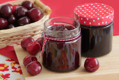Homemade cherry jam and fresh cherries on background. Homemade cherries jam and fresh cherries Royalty Free Stock Photos