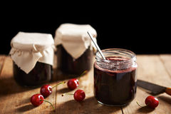 Homemade cherry jam in jars Royalty Free Stock Image