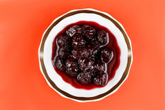 Homemade cherry jam on a saucer Stock Photography