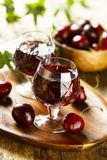 Homemade cherry liquor served in glasses stock photo