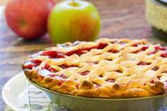 Homemade Cherry Pie. Cooling with fruit in the background Stock Image