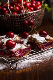 Homemade cherry pie. Covered in sugar with fresh cherries on top Royalty Free Stock Image