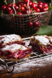 Homemade cherry pie. Covered in sugar with fresh cherries on top Stock Photos