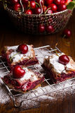 Homemade cherry pie. Covered in sugar with fresh cherries on top Royalty Free Stock Photos
