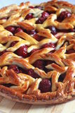 Homemade cherry pie with decorative lattice top Royalty Free Stock Image
