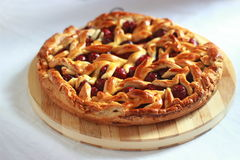 Homemade cherry pie with decorative lattice top Royalty Free Stock Photo