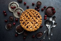 Homemade cherry pie. On rustic background Royalty Free Stock Photo