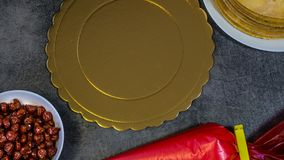 Homemade cherry pie, on a stone table, biscuits, pastry bag with cream, cherries stock images