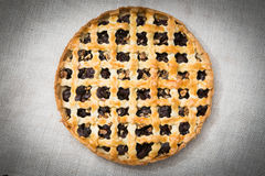 Homemade cherry pie with walnuts and a crispy crust. Royalty Free Stock Photo