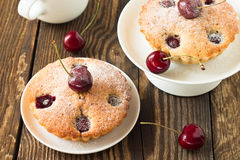 Homemade cherry pie on a white plate. On a wooden boards background royalty free stock image