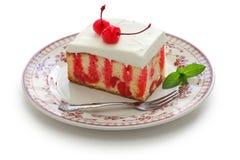 Homemade cherry poke cake stock photos