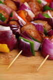 Homemade Chicken and Bacon Skewers Kebabs with Peppers Onions and Herb Marinate on wooden background Stock Photography
