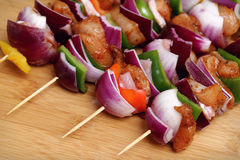 Homemade Chicken and Bacon Skewers Kebabs with Peppers Onions and Herb Marinate on wooden background. Homemade Chicken and Bacon Skewers Kebabs with Peppers Stock Image