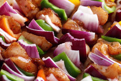 Homemade Chicken and Bacon Skewers Kebabs with Peppers Onions and Herb Marinate on wooden background Stock Photo