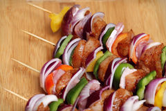 Homemade Chicken and Bacon Skewers Kebabs with Peppers Onions and Herb Marinate on wooden background. Homemade Chicken and Bacon Skewers Kebabs with Peppers Stock Photos
