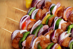 Homemade Chicken and Bacon Skewers Kebabs with Peppers Onions and Herb Marinate on wooden background. Homemade Chicken and Bacon Skewers Kebabs with Peppers Royalty Free Stock Images