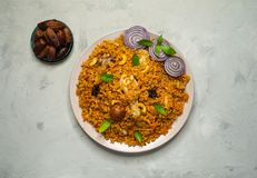 Homemade chicken Biryani. Arabic traditional food. Bowls kabsa with meat. Top view royalty free stock photos