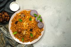Homemade chicken Biryani. Arabic traditional food. Bowls kabsa with meat. Top view royalty free stock photography