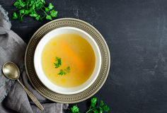 Homemade chicken bouillon. Or broth, view from above Stock Photo