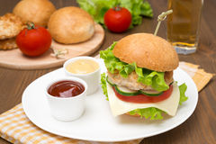 Homemade chicken burger with ketchup and mustard Royalty Free Stock Photography
