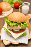 Homemade chicken burger with vegetables, cheese and sauces Royalty Free Stock Photo