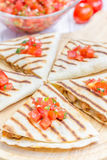 Homemade chicken and cheese quesadilla with salsa. Closeup Stock Photos