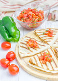 Homemade chicken-cheese quesadilla with salsa on top. Closeup Stock Images