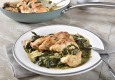Homemade chicken florentine. Gourmet homemade chicken florentine with a cast iron skillet in the background royalty free stock photos