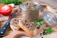Homemade chicken liver pate on baguette adn with tomatoes Royalty Free Stock Photography