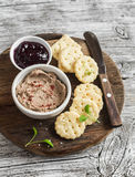 Homemade chicken liver pate, cranberry sauce and homemade cheese biscuits. Delicious snack or appetizer with wine. Royalty Free Stock Photography