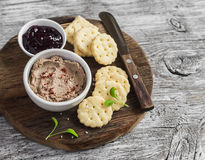 Homemade chicken liver pate, cranberry sauce and homemade cheese biscuits. Delicious snack or appetizer with wine. Royalty Free Stock Images