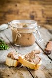 Homemade chicken liver pate with fresh baguette. On rustic wooden table Stock Photos