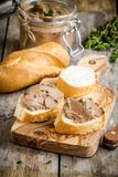 Homemade chicken liver pate with fresh baguette. On rustic wooden table Stock Photo