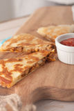 Homemade chicken mexican quesadilla on wooden Royalty Free Stock Photos