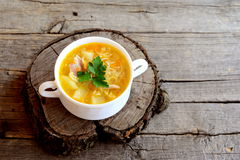 Homemade chicken noodle soup in a bowl. Soup cooked in chicken broth with potatoes, noodles, onions and carrots Royalty Free Stock Image