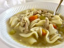 Chicken noodle soup. Homemade chicken noodle soup in a white bowl royalty free stock photography