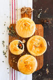 Homemade chicken pot pies on a wooden board royalty free stock photography
