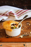 Homemade chicken pot pies on a wooden board Stock Image