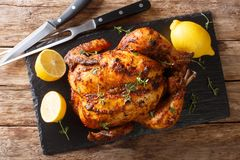 Free Homemade Chicken Rotisserie With Thyme, Lemon Closeup On A Slate Board. Horizontal Top View Stock Photos - 165315293