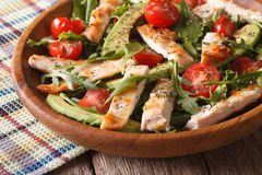 Homemade chicken salad with avocado and arugula closeup. horizon Royalty Free Stock Photos
