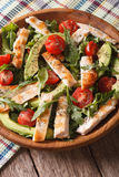 Homemade chicken salad with avocado and arugula closeup. Vertica Royalty Free Stock Image