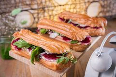 Homemade chicken salad eclair on a wood board. royalty free stock image