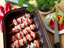 Homemade chicken skewers with red pepper. Ready skewers preparing in a roasting pan before baking Royalty Free Stock Photography