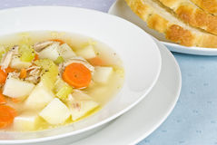 Homemade Chicken Soup and Bread Stock Photography